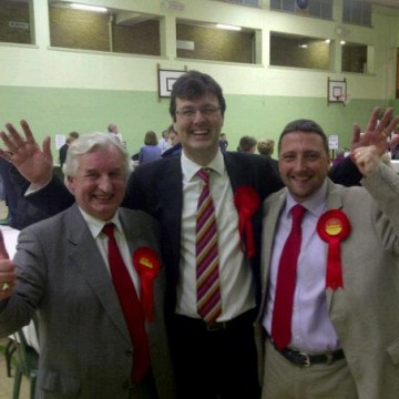 Rob Evans, Duncan Enright and Andrew Coles celebrate at the West Oxfordshire count.