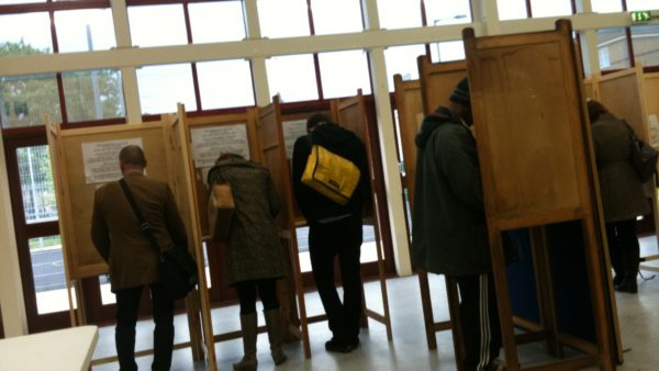 People voting in a polling booth