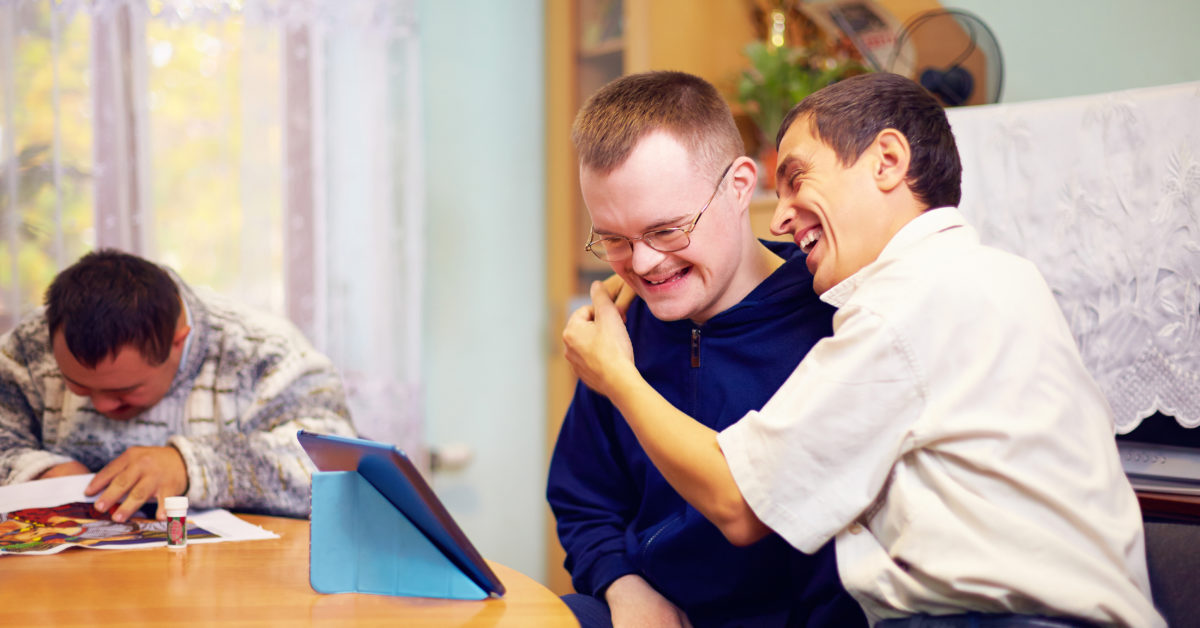 happy friends with disability socialising