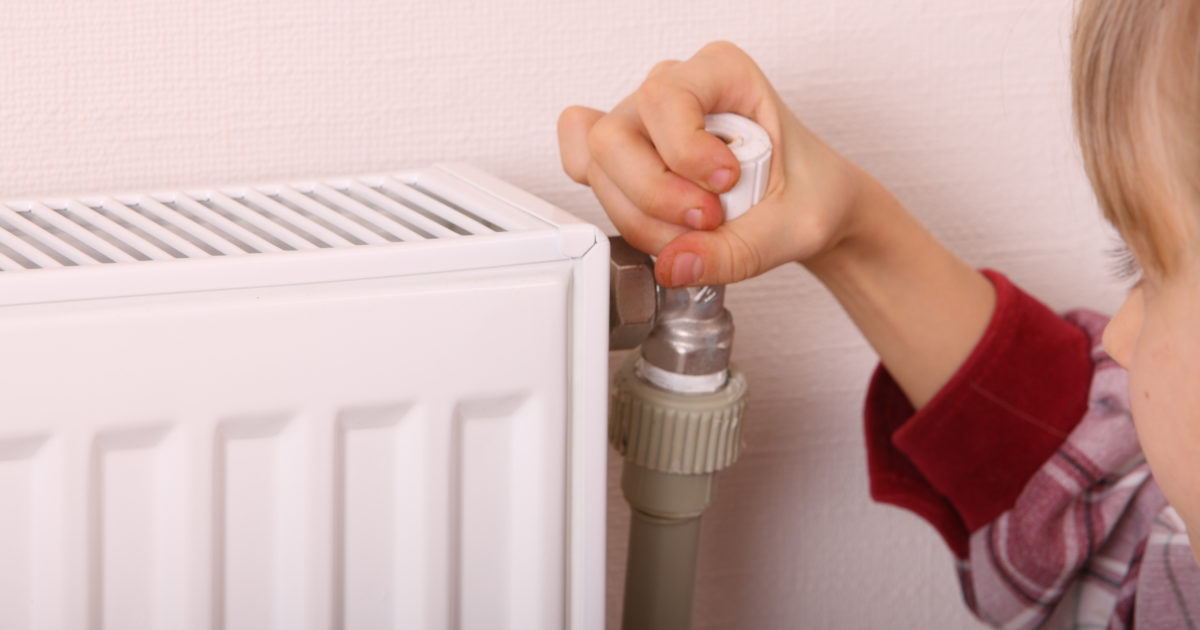 Girl thermostat on radiator