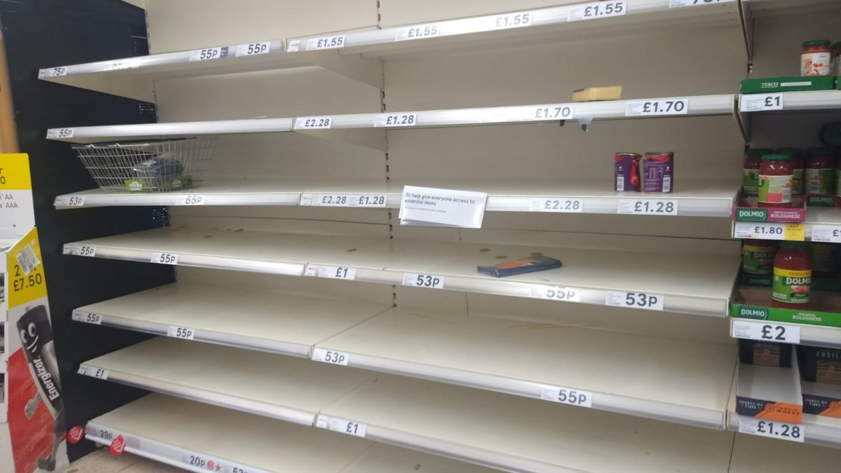 A picture showing empty pasta shelves in a British supermarket