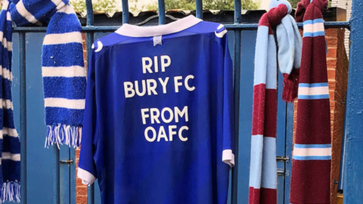 A football shirt reading RIP Bury FC