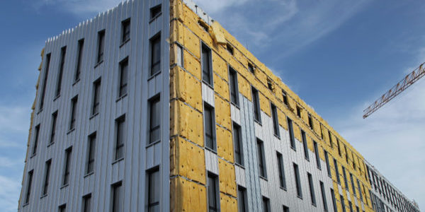 Exterior cladding on an apartment block in construction