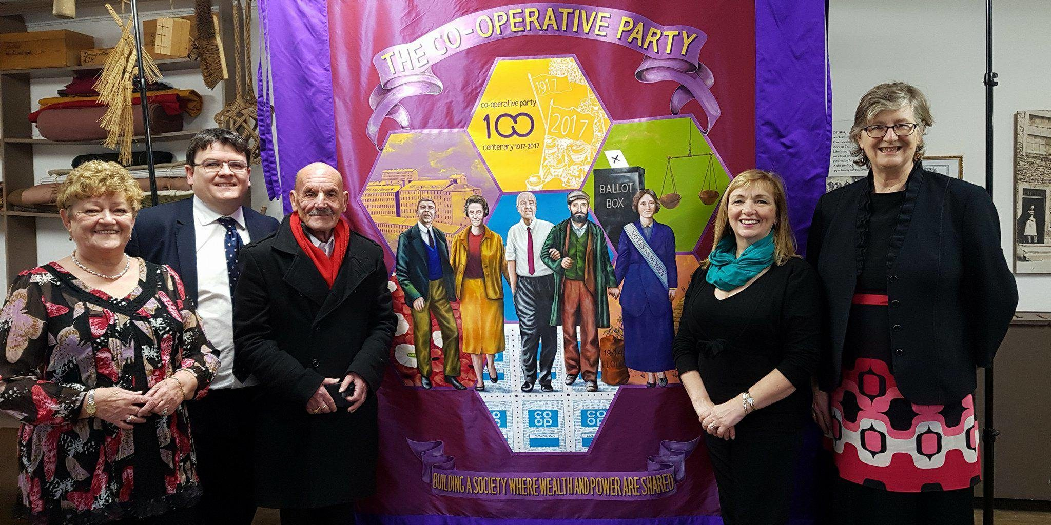 Scottish Co-operative Party members with the Party's Centenary banner at New Lanark.